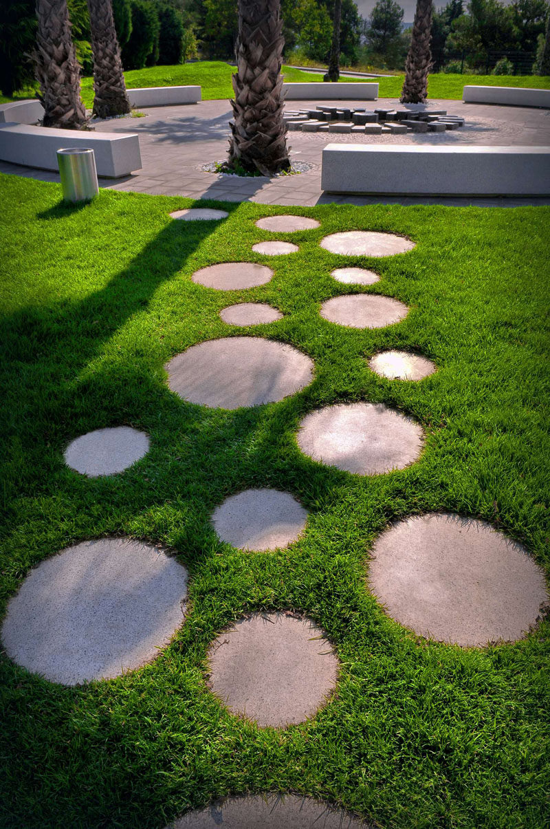10 Ideas for Stepping Stones in Your Garden // These round stepping stones surrounded by grass, connect the various areas of this Slovenian park, and a touch of fun with their circular shape reminiscent to bubbles or marbles.