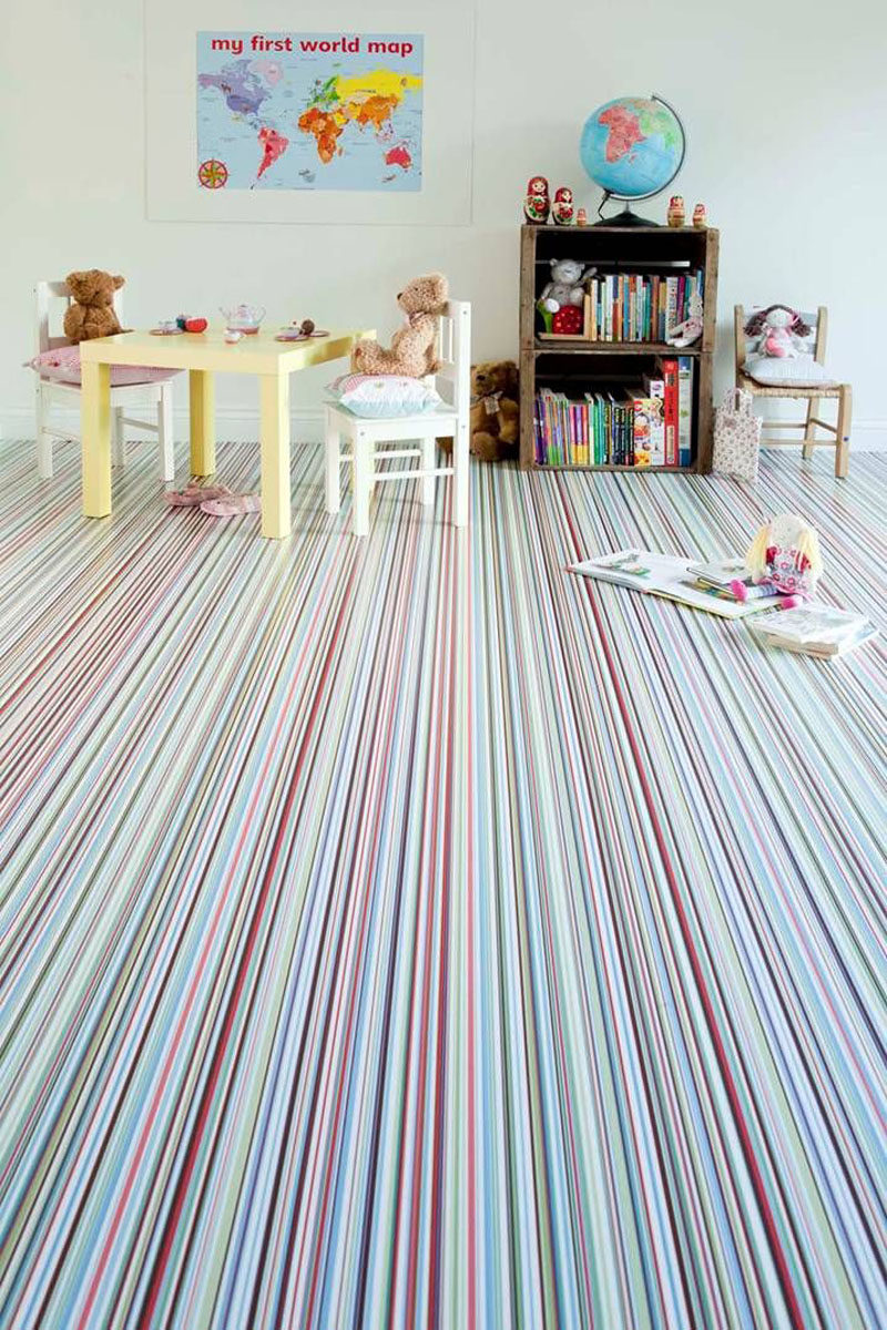 7 Examples Of Striped Floors In Contemporary Homes // This playroom is made even more fun with the wall to wall thinly striped carpet in bright colors.