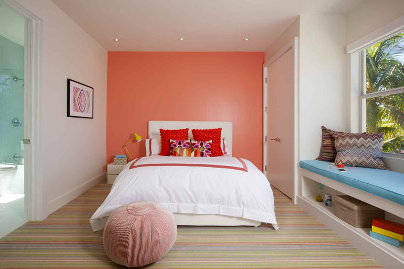 7 Examples Of Striped Floors In Contemporary Homes // The colors of the stripes in this carpet amp up the brightness and the playfulness in this colorful bedroom.