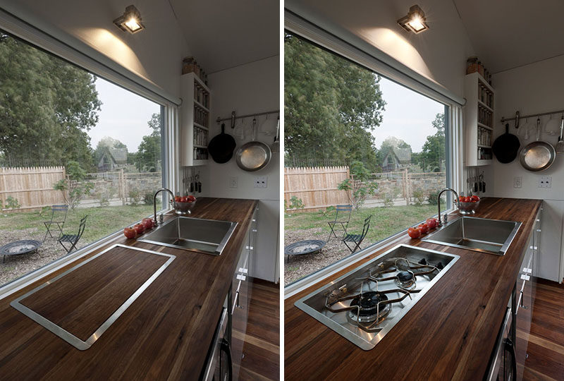 In tiny tiny home, the kitchen has a cover to hide the cooktop and provide additional prep space for when you're getting ready to cook.
