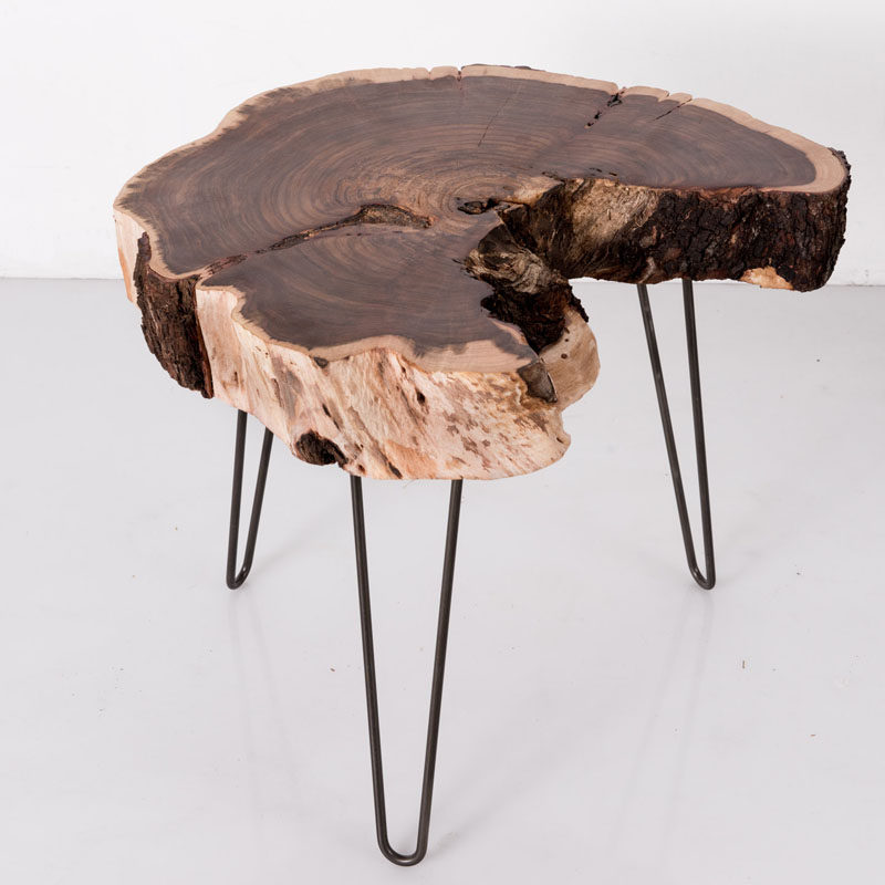 9 Ideas For Including Tree Stumps In Your Home Decor // Rescued stumps from Los Angles forests serve as the table top of these handmade stools and tables.