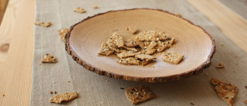 9 Ideas For Including Tree Stumps In Your Home Decor // This bowl made from a thin slice of a tree trunk can be used to hold decorative things or can be used as a serving plate for snacks like chips or crackers.