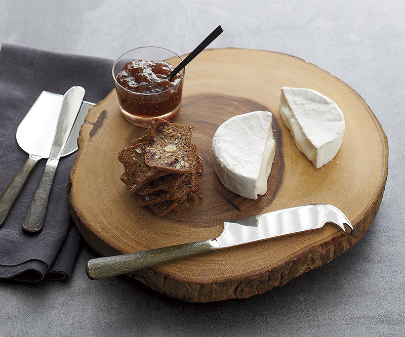 9 Ideas For Including Tree Stumps In Your Home Decor // Cheese and cutting boards created from slices of tree stumps add a rustic yet modern feel to any dinner party.