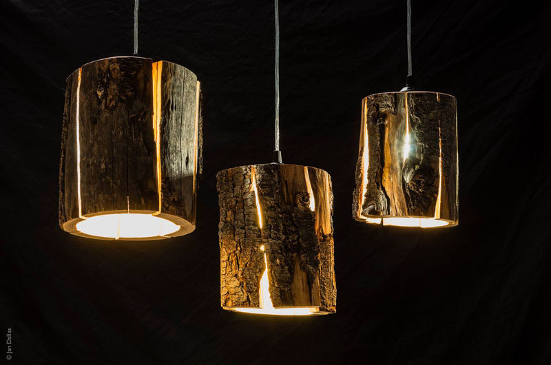 9 Ideas For Including Tree Stumps In Your Home Decor // Made by artist Duncan Meerding, these cracked log pendant lamps embrace the naturally occurring cracks in the wood and use them to emit light from within the stump.