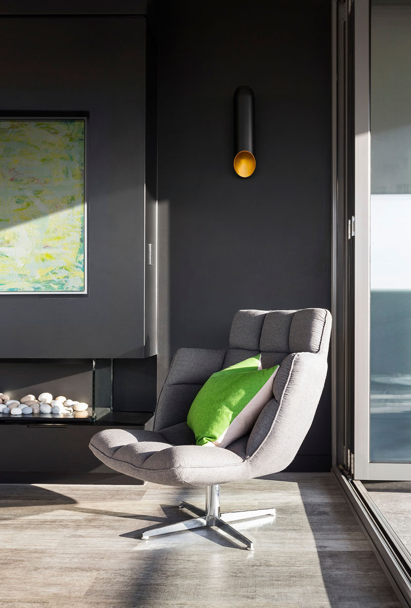 A green cushion ties in with the artwork in this interior.