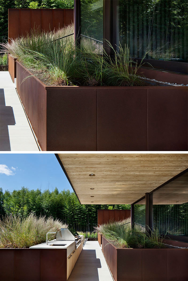 9 Ideas For Including Weathering Steel Planters In Your Garden // Huge planters fill the backyard patio of this family home, and make dinner parties feel like they're taking place in the well-groomed great outdoors.