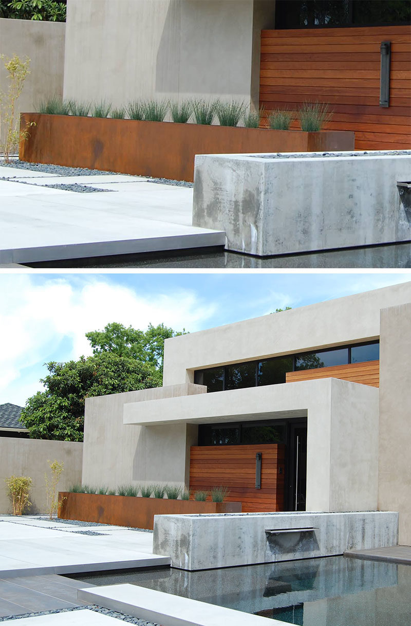 9 Ideas For Including Weathering Steel Planters In Your Garden // The color of the weathered steel of this oversized planter matches that of the wood doors on the exterior of this home and creates a tied together look and feel.