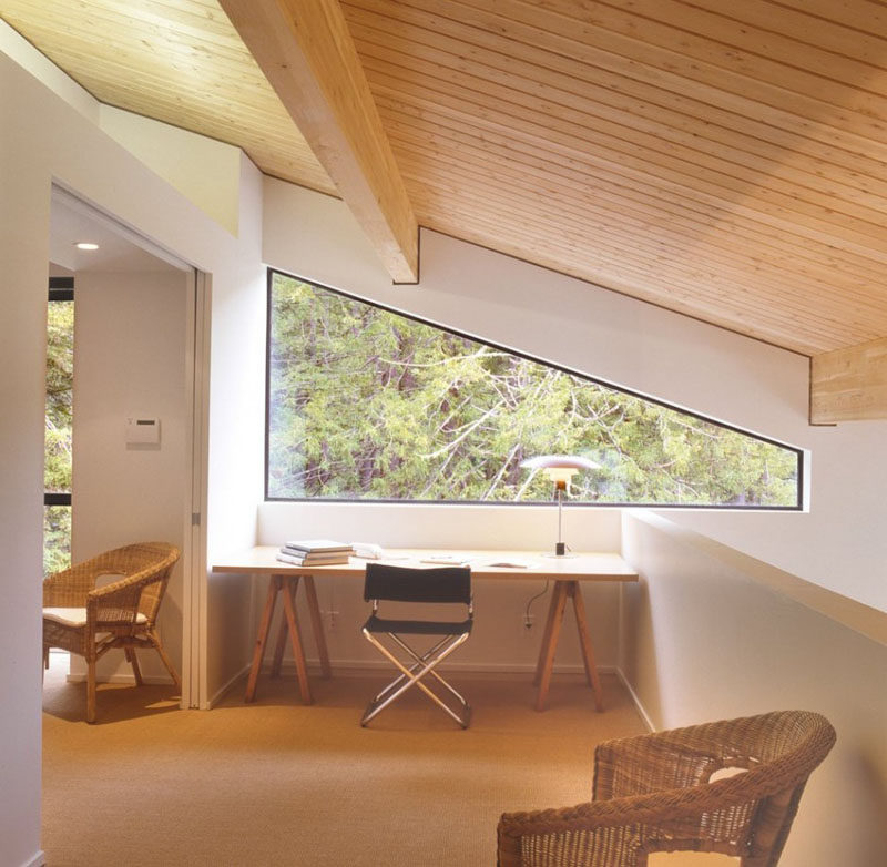15 Awesome Examples Where Windows Follow The Roofline // The top of this window is angled almost into a triangle shape as it follows the angle of the roof down the side of the wall.