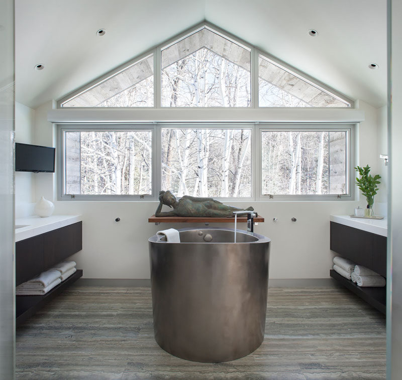 15 Awesome Examples Where Windows Follow The Roofline // The top window in this bathroom sits at a perfect angle with the roof above it, helping tub dwellers sink even further into relaxation.