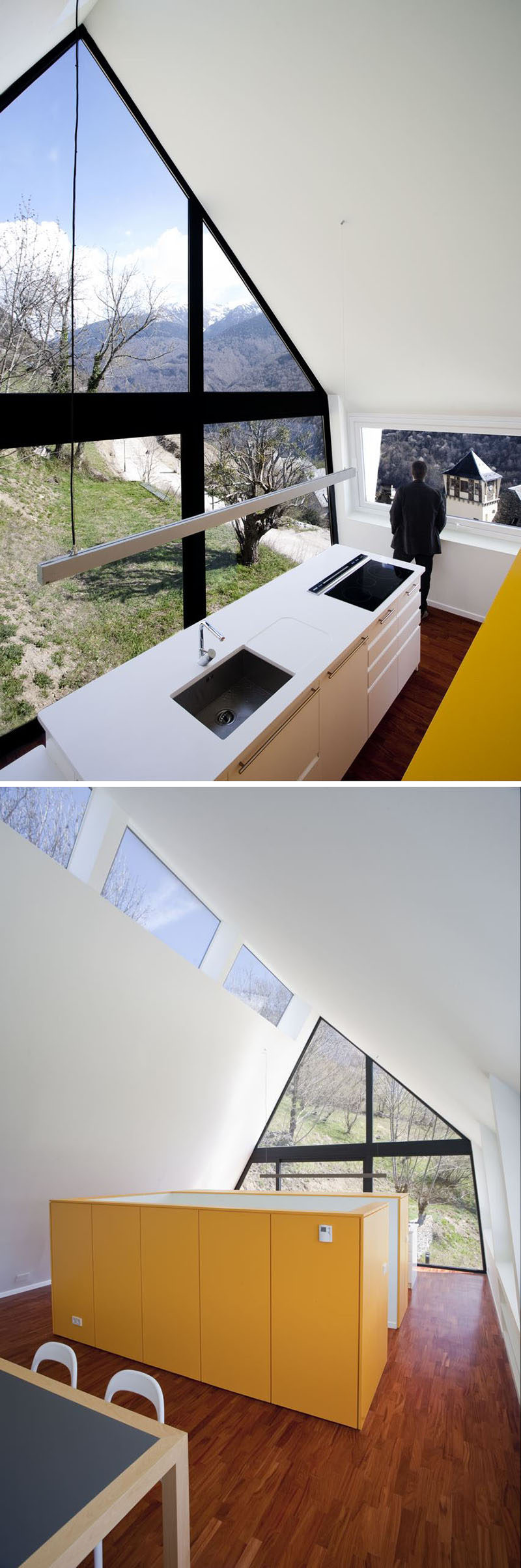15 Awesome Examples Where Windows Follow The Roofline // The black frames of the this floor to ceiling window align with the edges of the roof and create a striking contrast with the white walls.
