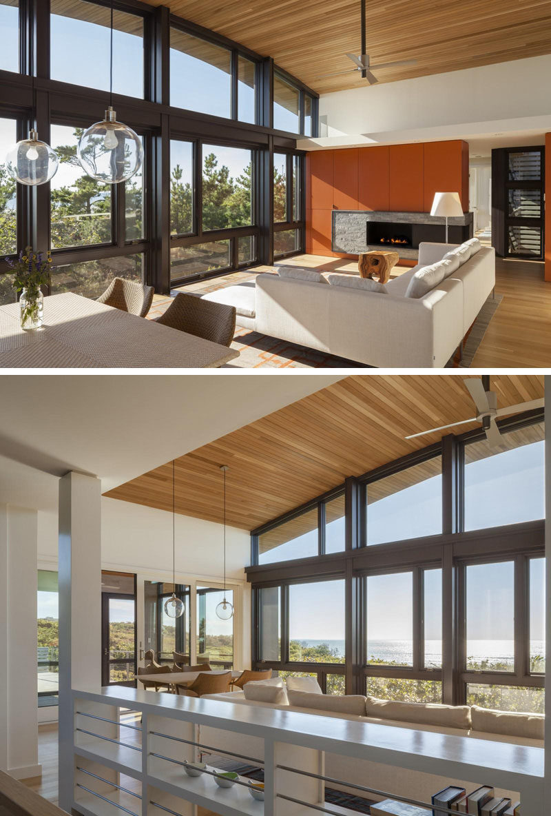 15 Awesome Examples Where Windows Follow The Roofline // The slight curve of the top part of this massive window follows the curve of the roof on this Cape Cod home.