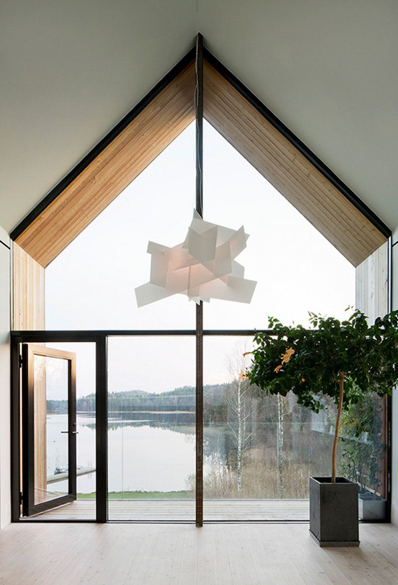 15 Awesome Examples Where Windows Follow The Roofline // This wall of glass offers incredible views of the lake outside and matches the angles of the roof while also following the lines of the walls.