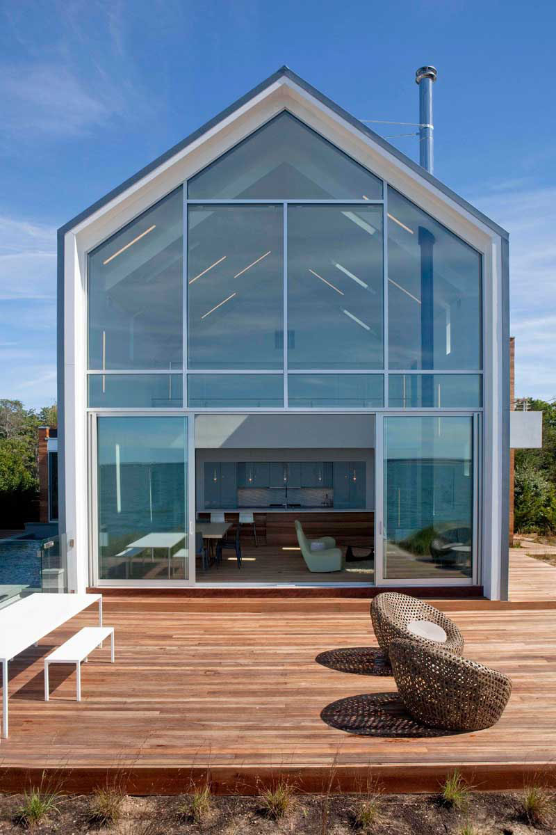 15 Awesome Examples Where Windows Follow The Roofline // This rear window covers the entirety of the back of the house and fits perfectly into the angles of the home.