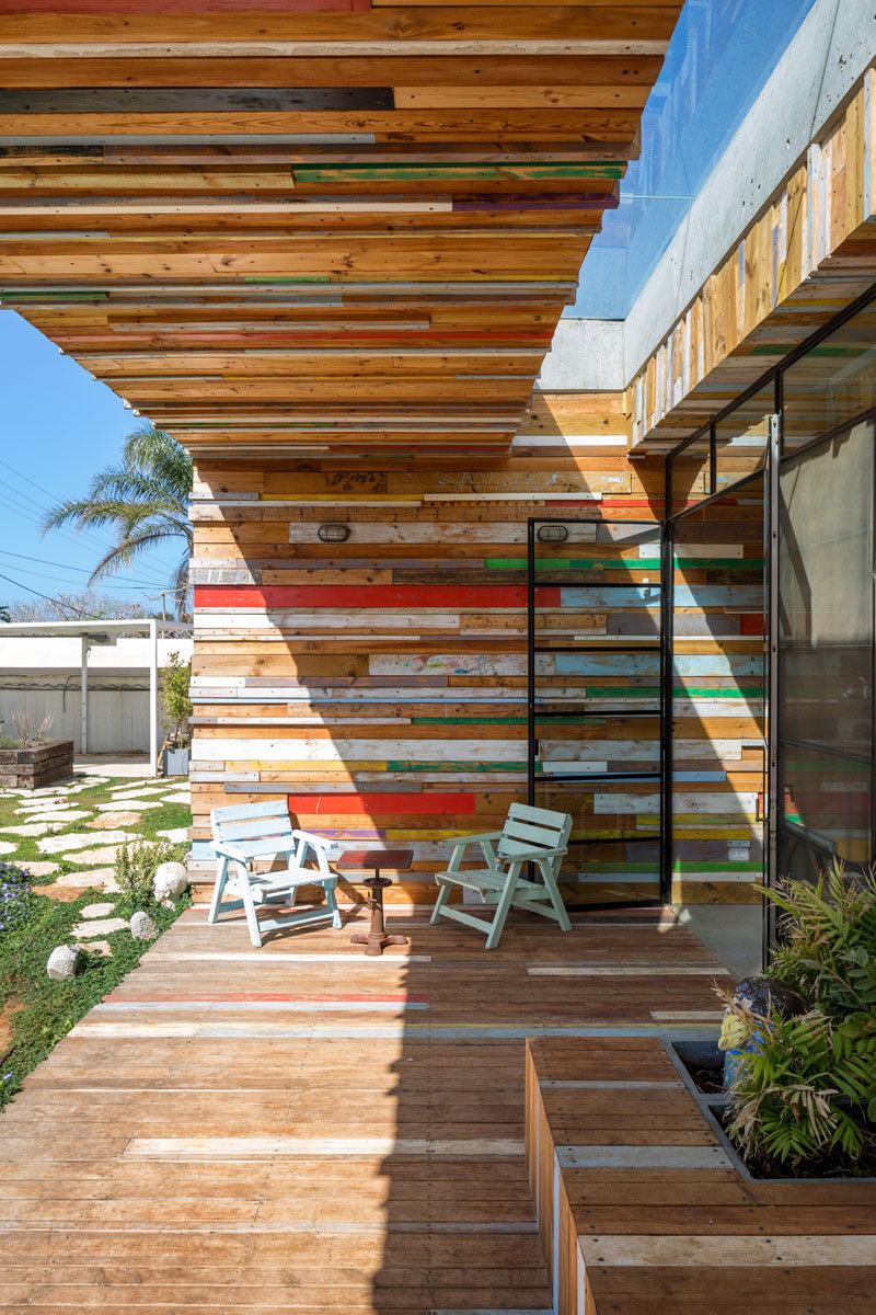 This fun outdoor patio area of a home in Israel, is covered in scrap wood.