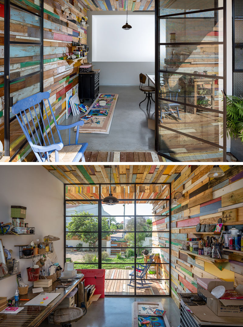 This home's covered patio provides access to an art studio, where the scrap wood feature wall flows through seamlessly to the inside of the home.