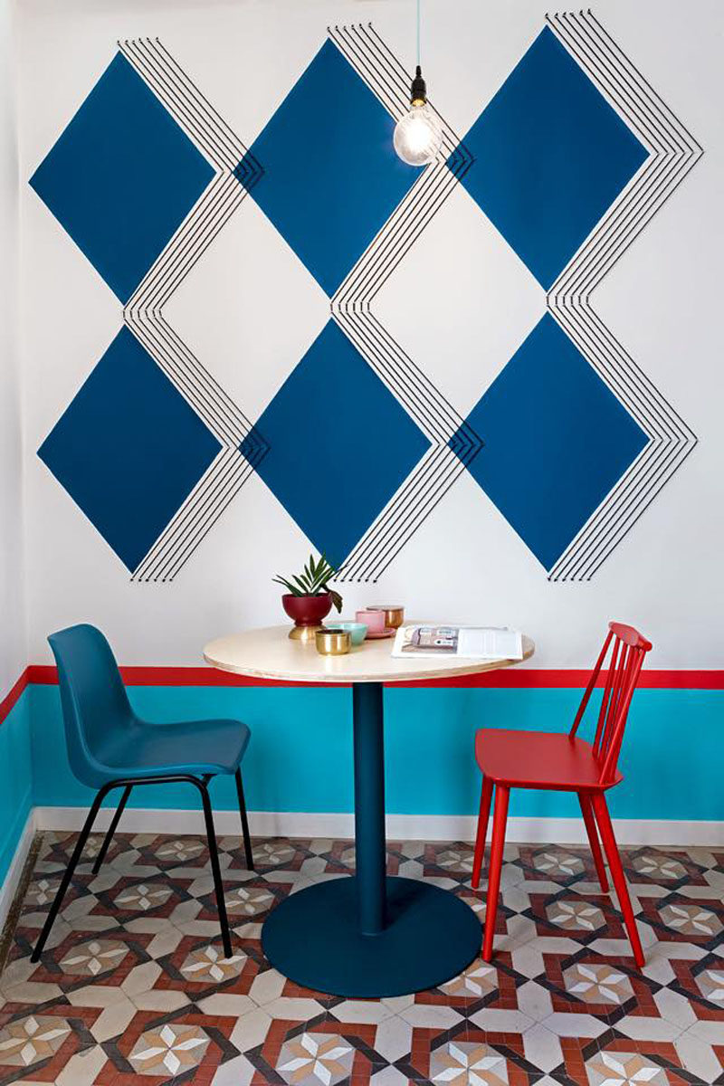 Wall Decor Inspiration - Bold Graphics Cover The Walls Of This Spanish Hostel // Large blue diamonds feature on this wall with black stripes adding to the 3-dimensional look of the diamonds.