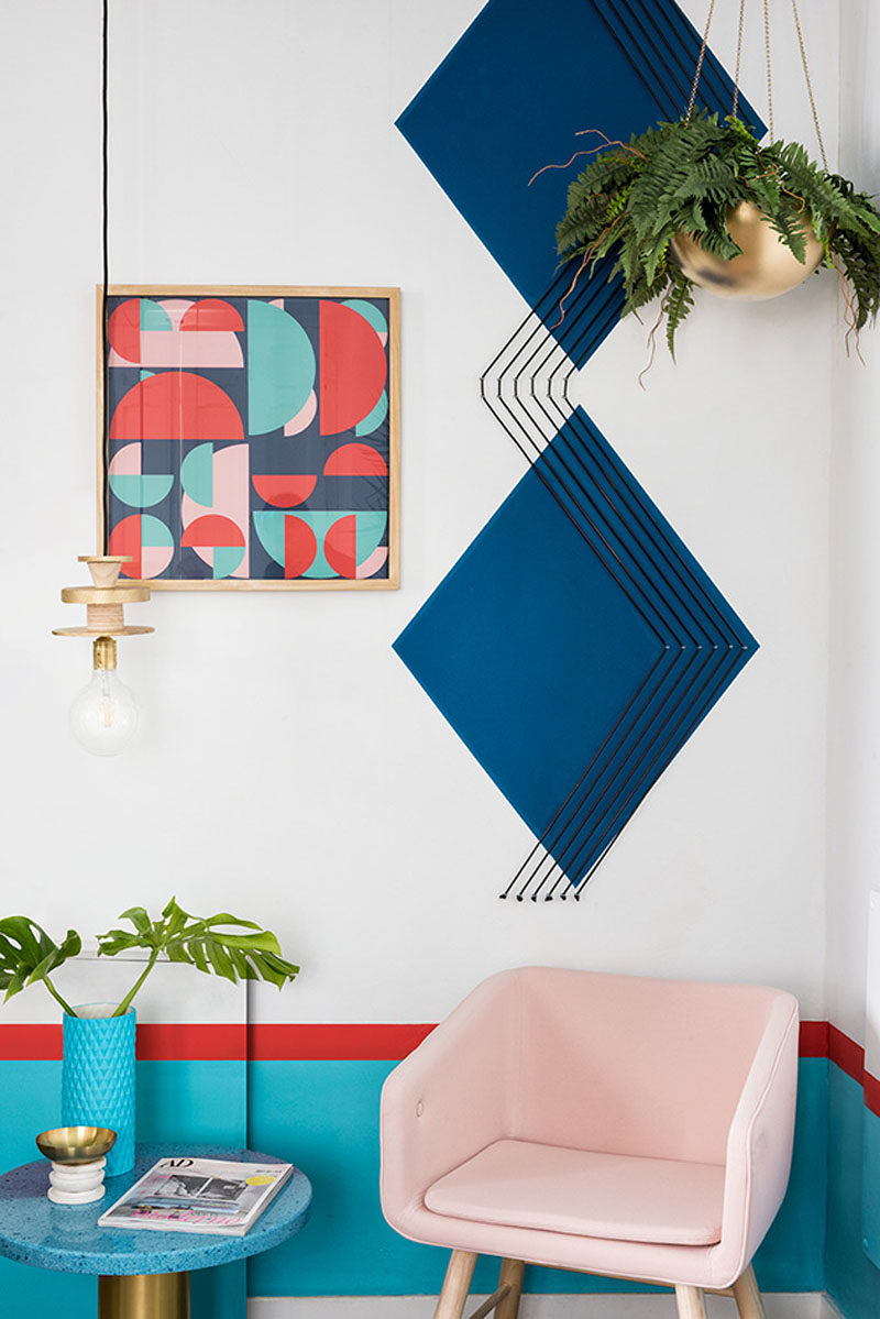 Wall Decor Inspiration - Bold Graphics Cover The Walls Of This Spanish Hostel // Large dark blue diamonds and graphic artwork liven this corner up.