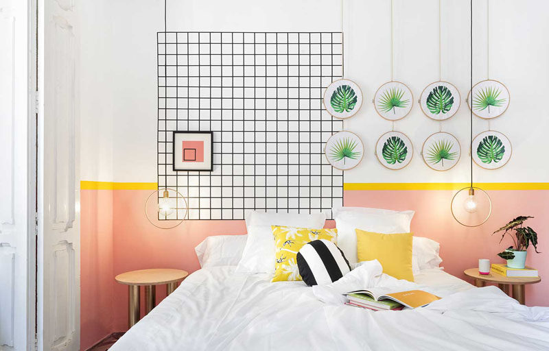 Wall Decor Inspiration - Bold Graphics Cover The Walls Of This Spanish Hostel // Botanical inspired art is paired with a black grid to decorate this hostel room.