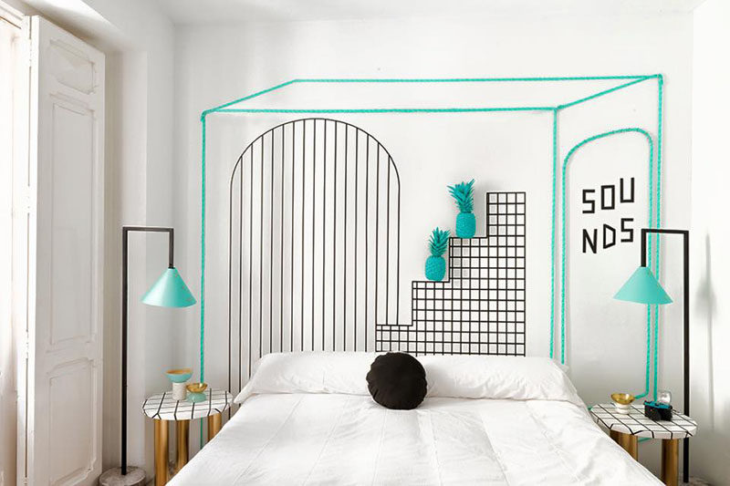 Wall Decor Inspiration - Bold Graphics Cover The Walls Of This Spanish Hostel // Turquoise and black graphics and lamps stand out in this white hostel room.
