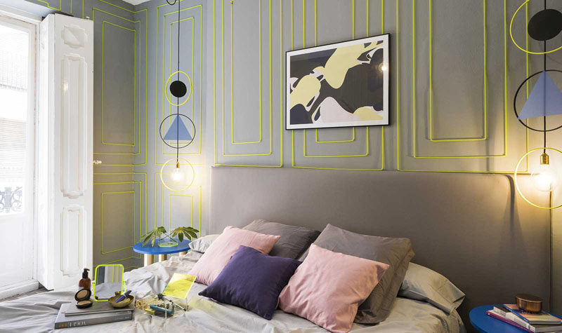 Wall Decor Inspiration - Bold Graphics Cover The Walls Of This Spanish Hostel // Green rectangular neon art livens up the walls of this mostly grey room.