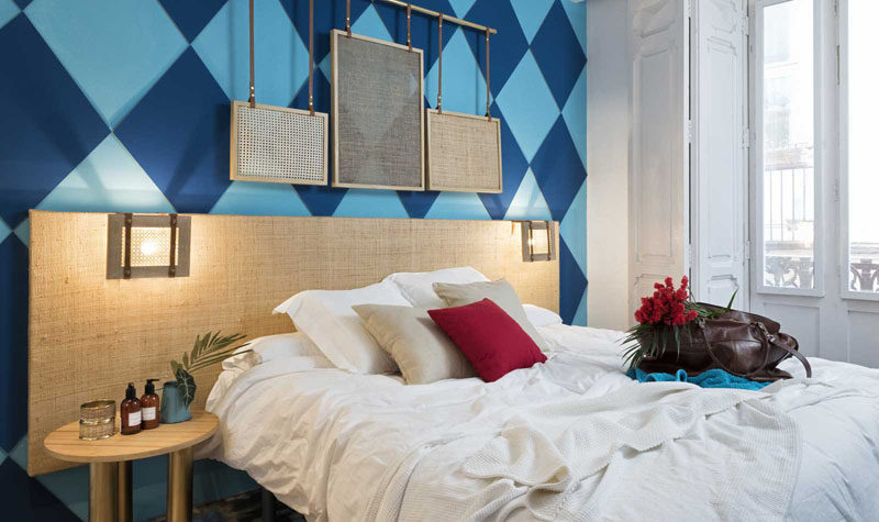 Wall Decor Inspiration - Bold Graphics Cover The Walls Of This Spanish Hostel // A two-tone blue diamond wall is a bold choice for this hostel room.