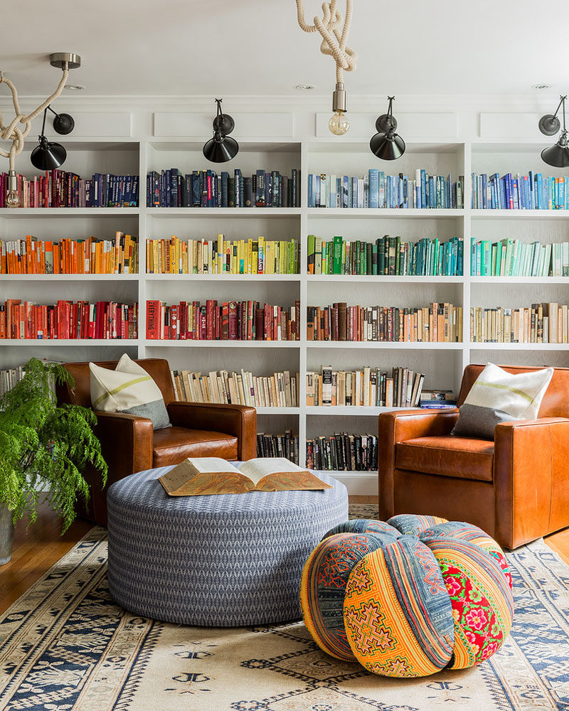 9 Ideas for Creating a Stylish Bookshelf // Color blocking --- If you have lots of books, chances are you'll be able to sort them into colors. Arrange them on your shelves in their groups of colors and you'll have a creative display that will inspire all who visit to pick up a book and start reading.