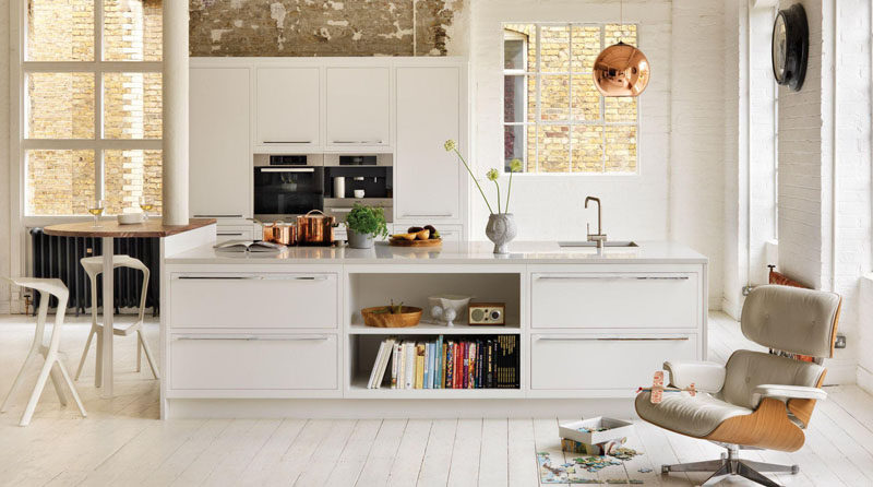 9 Examples Of Kitchens With Built-In Coffee Machines // The built-in stainless steel coffee maker in this kitchen matches the other appliances perfectly and contributes to the overall modern feel of the loft.