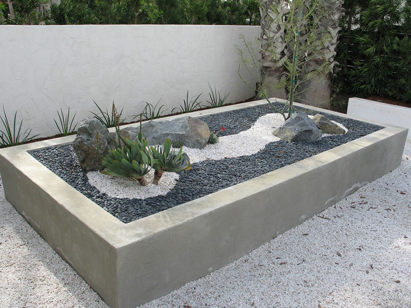 10 Inspirational Ideas For Including Custom Concrete Planters In Your Yard  // This Large Concrete