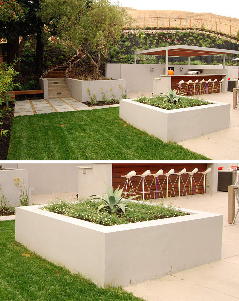 10 Inspirational Ideas For Including Custom Concrete Planters In Your Yard // The large square concrete planter in this yard divides the entertaining area from the the rest of the garden, and looks great while doing it.