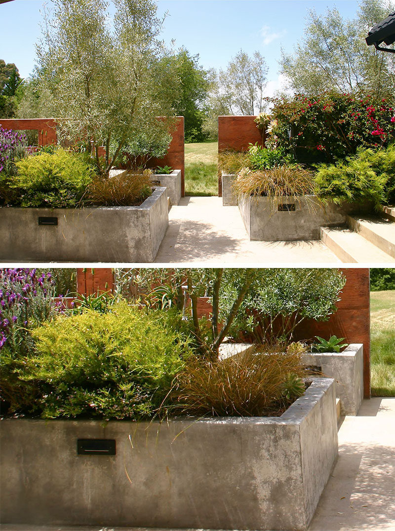 10 Inspirational Ideas For Including Custom Concrete Planters In Your Yard // Large concrete planters fill this back patio and create lots of space for plants without making it feel overrun or unmanageable.