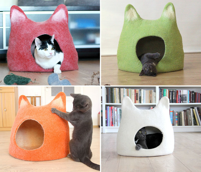 11 Cat Caves That Prove Cat Beds Can Be Stylish // Colorful felted beds in the shape of cat heads provide a cozy spot to curl up in or a convenient place to scratch away at.