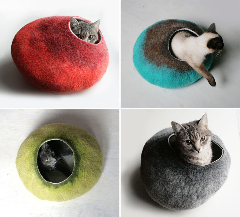 11 Cat Caves That Prove Cat Beds Can Be Stylish // These multi-toned felted cat beds have little openings that they can stick their heads out of and survey their surroundings from.