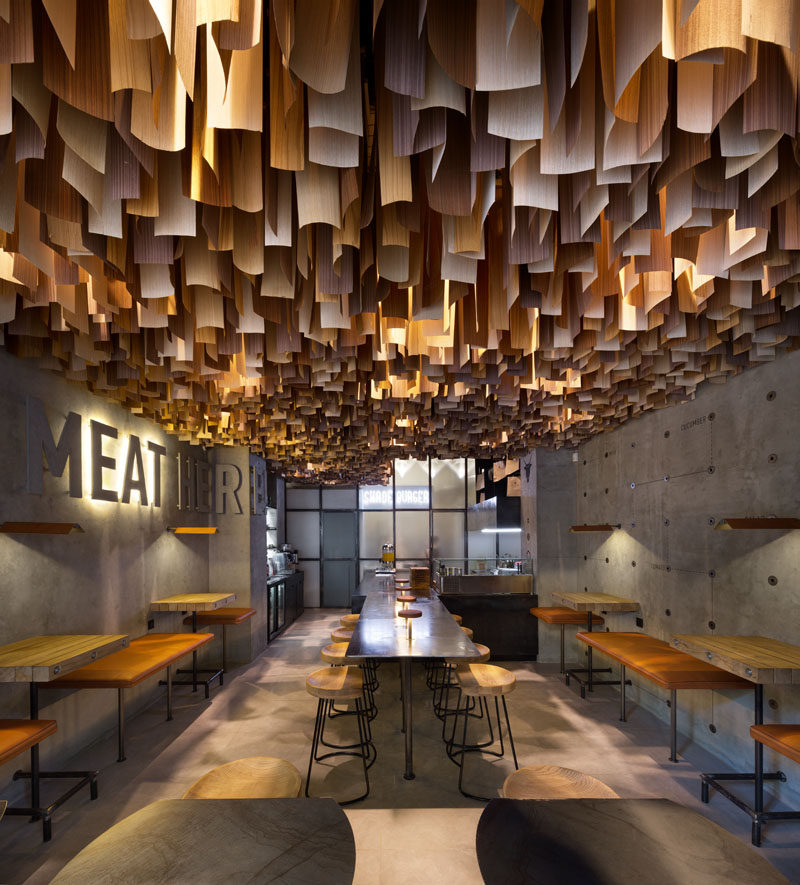Wood Veneers Suspended From The Ceiling Create A Dramatic