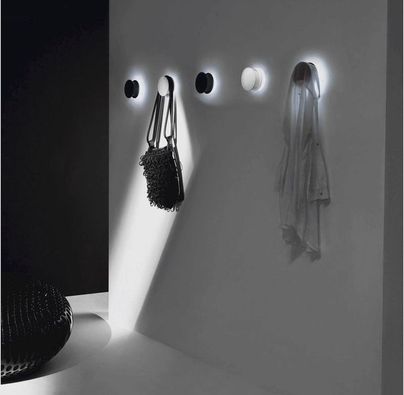 11 Creative Coat Hooks To Keep Your Clothes And Bags Off The Floor // White LED lights attached to the back of these coat hooks illuminate your hallway and cast a bright glow around your bags and coats. #CoatHooks #WallHook #ModernWallHook