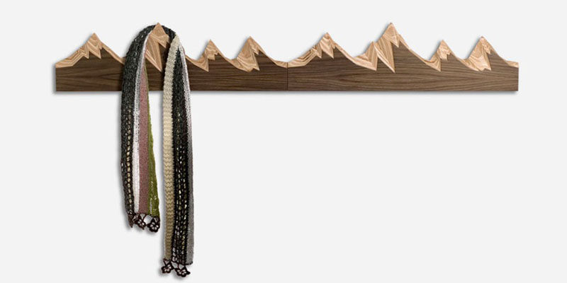 11 Creative Coat Hooks To Keep Your Clothes And Bags Off The Floor // These coat hooks, inspired by snow-capped mountains, add a bit of nature to your home and provide a convenient place to hang your things as you walk into the house. #CoatHooks #WallHook #ModernWallHook