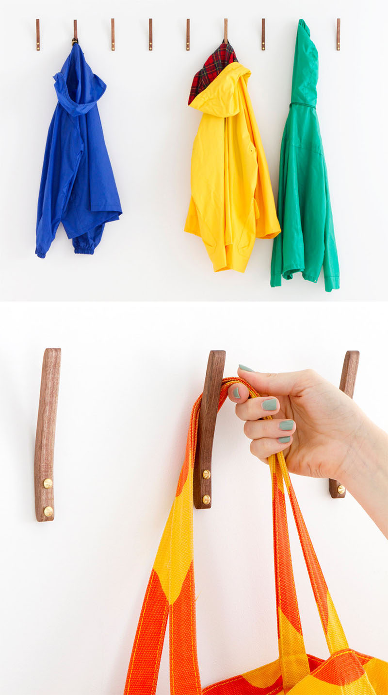 11 Creative Coat Hooks To Keep Your Clothes And Bags Off The Floor // This simple steam bent wooden hook adds a touch of warmth to your walls and they are strong enough to hang jackets, backpacks, shirts and scarves. #CoatHooks #WallHook #ModernWallHook