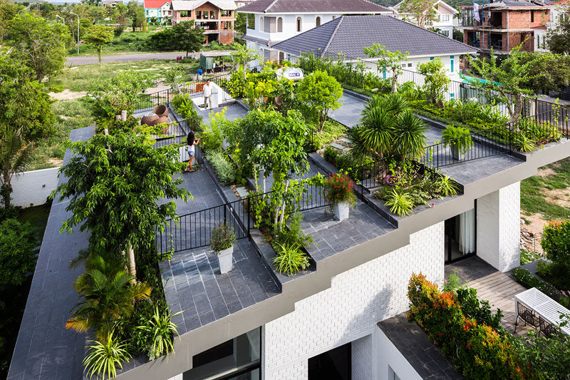 When the owners of this house requested a house with a large garden, the architects responded by designing a house with a terraced roof, filled with plants.
