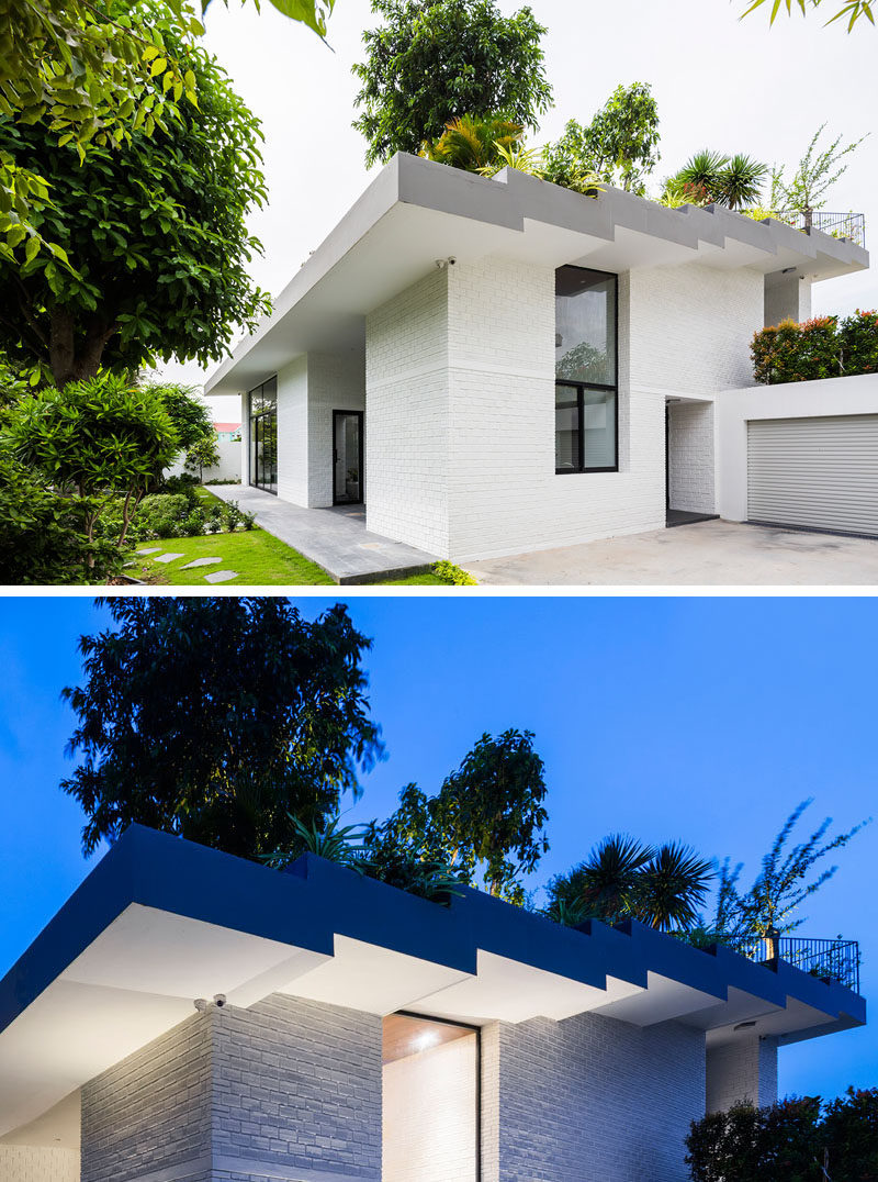 This home, located in Nha Trang, Vietnam, and designed by Vo Trong Nghia Architects and ICADA, has a stepped roof, with various terraced spaces that has each step down filled with plants.