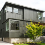 A dark board and batten clad home arrives on this street in Portland