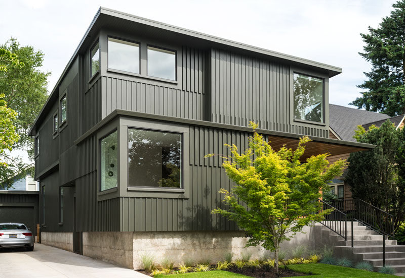 Beebe Skidmore have recently completed a new dark green home in Portland, that has a look influenced by the owners' attraction to spare, clean lines, careful use of color and material punches.