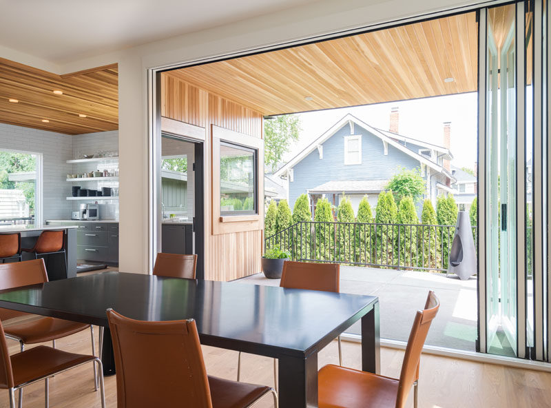 An accordion glass wall and separate side door, connect the back porch to both the kitchen and dining room. The back porch is large enough to be set up as an outdoor dining room for ten.