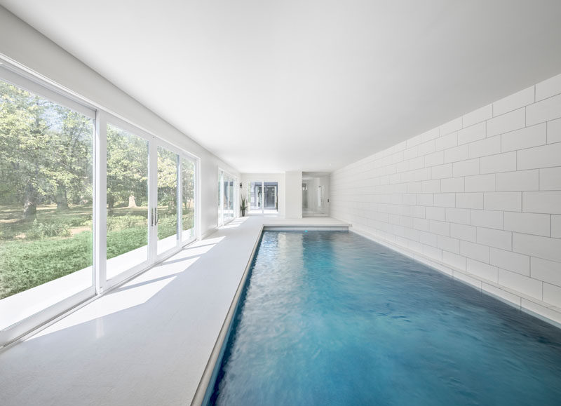 This indoor swimming pool area opens to the garden outside via large sliding doors.