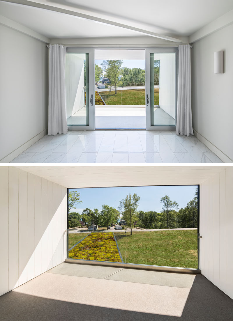 In this master bedroom tower, sliding doors open to a covered balcony, where views of the lake and the green roof below can be enjoyed.