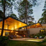 This new home of wood and stone was designed to enjoy the tranquility of the surrounding forest