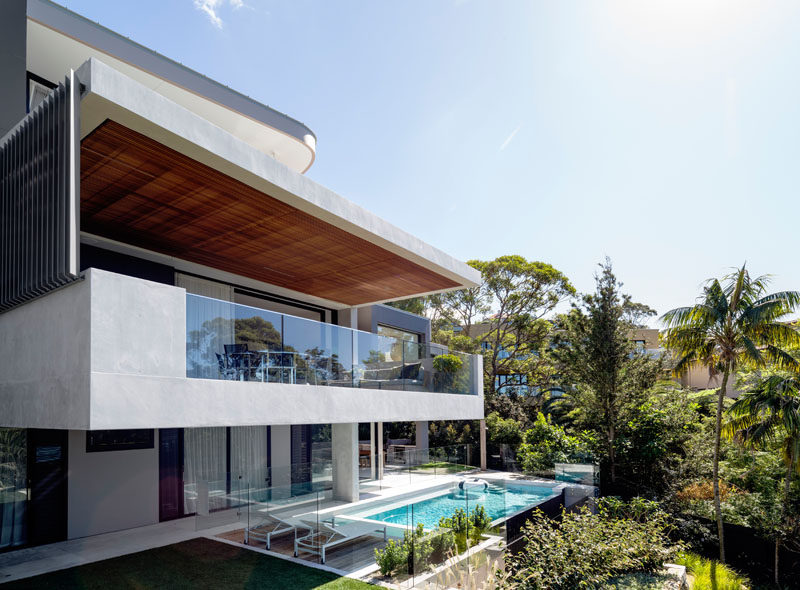 Set above a beach and adjacent to a nature reserve, is this three level home designed by Corben Architects.