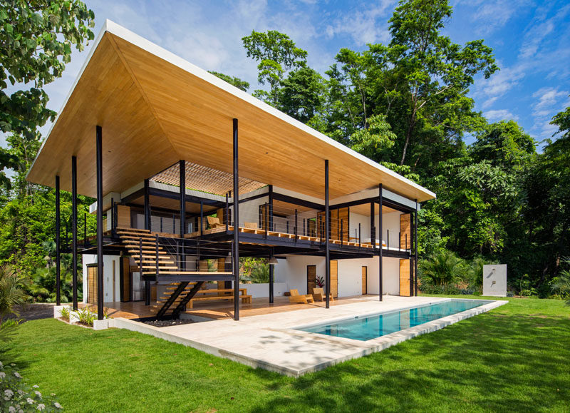 This recently completed home in Puntarenas, Costa Rica, is nestled between the jungle and the beach. Designed by Benjamin Garcia Saxe, the home is a series of interwoven terraces, creating multiple levels and opening the home to the outdoors.