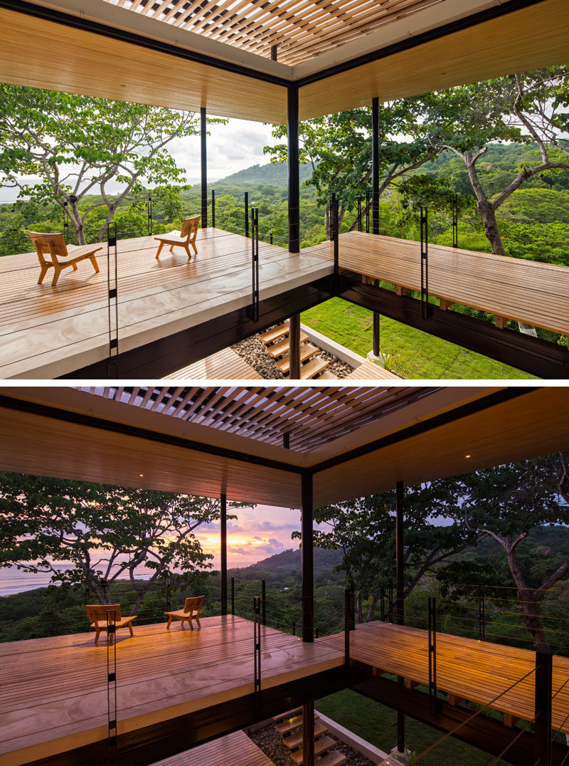 From the second level of this home, you are able to see the treetops of the forest and views of the water.