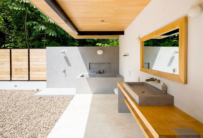 This bathroom in a house in Costa Rica, is wide open to the elements, and has all of the furniture, bath and shower built-in.