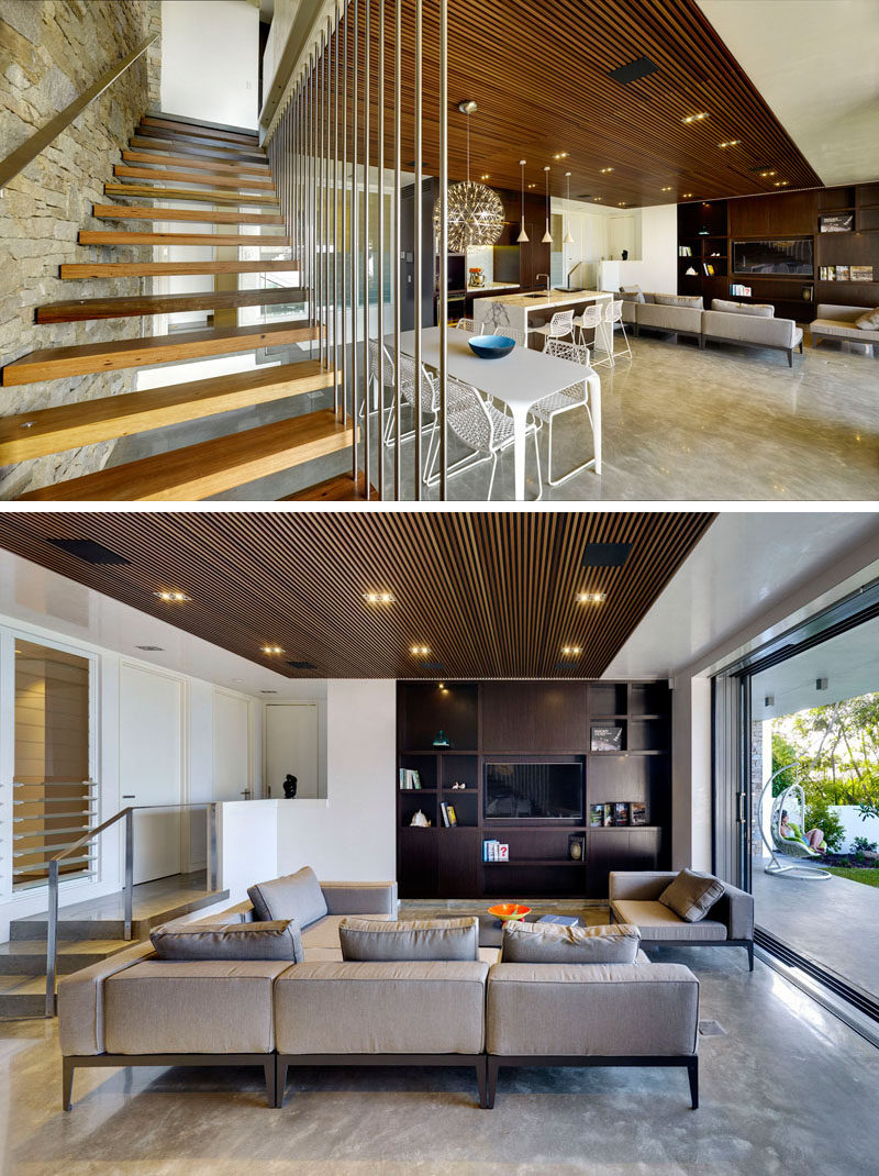Stone has been used on the wall next to the stairs, and the designers included built-in cabinetry in the living room.