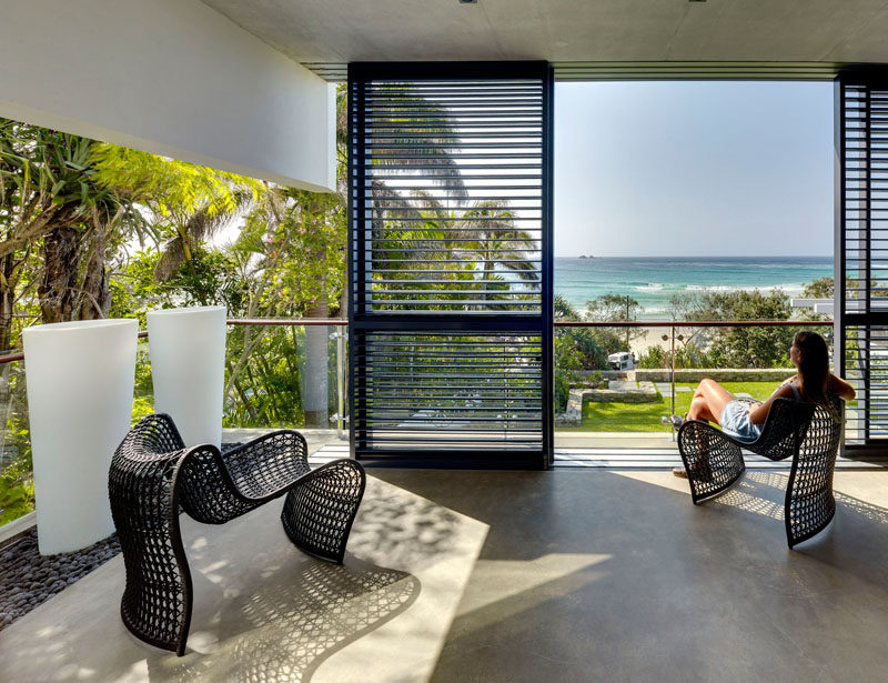 This covered balcony has views of the beach across the road.